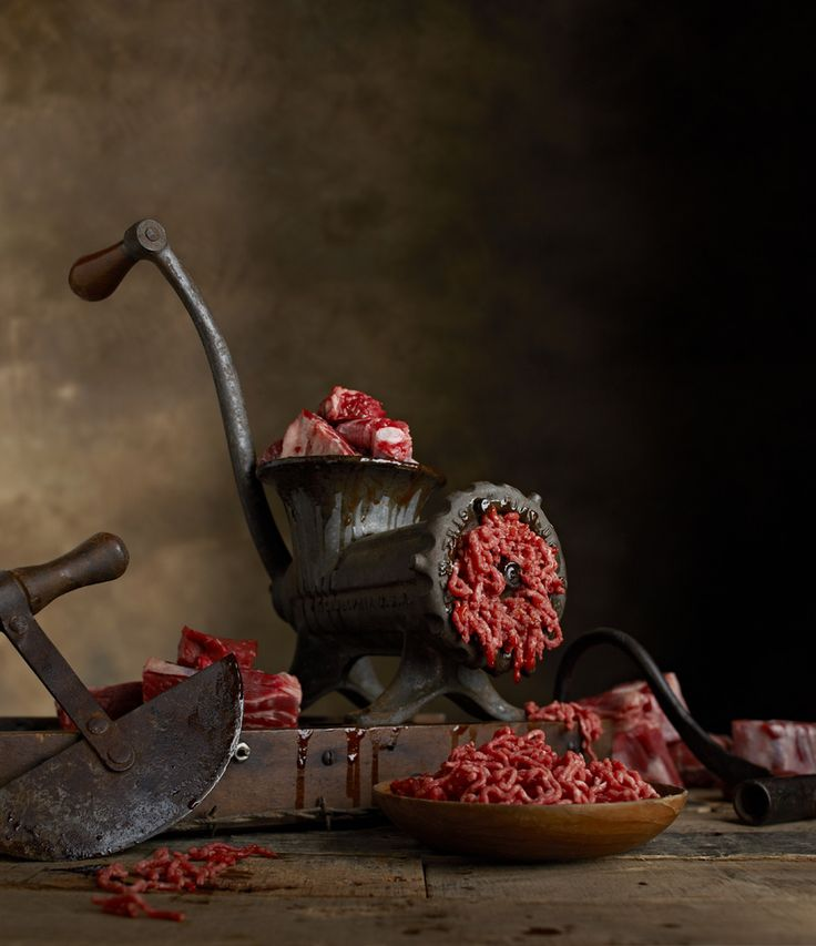 Raw meat through a vintage meat grinder. Lew Robertson Food Photography