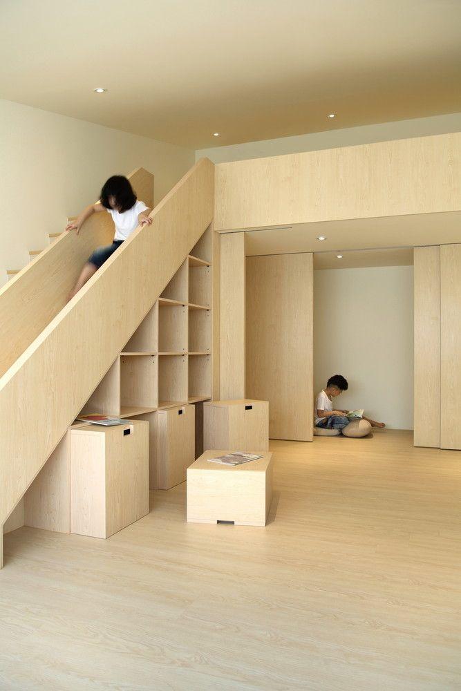 7 coole Gebäude mit Treppenrutschen und glücklichen Kindern