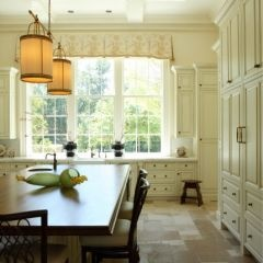 Different Approach to wood floors white kitchen I like. Still has a wonderful feel.