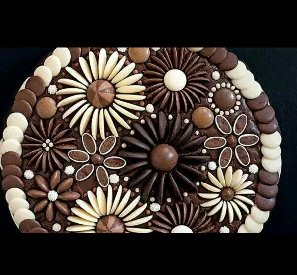 Chocolate cake decorated with buttons, minstrels, malteesers. Amazing!!!