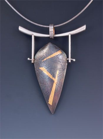 Wendy Walsh.  Hanging textured pod form in silver with keum boo.