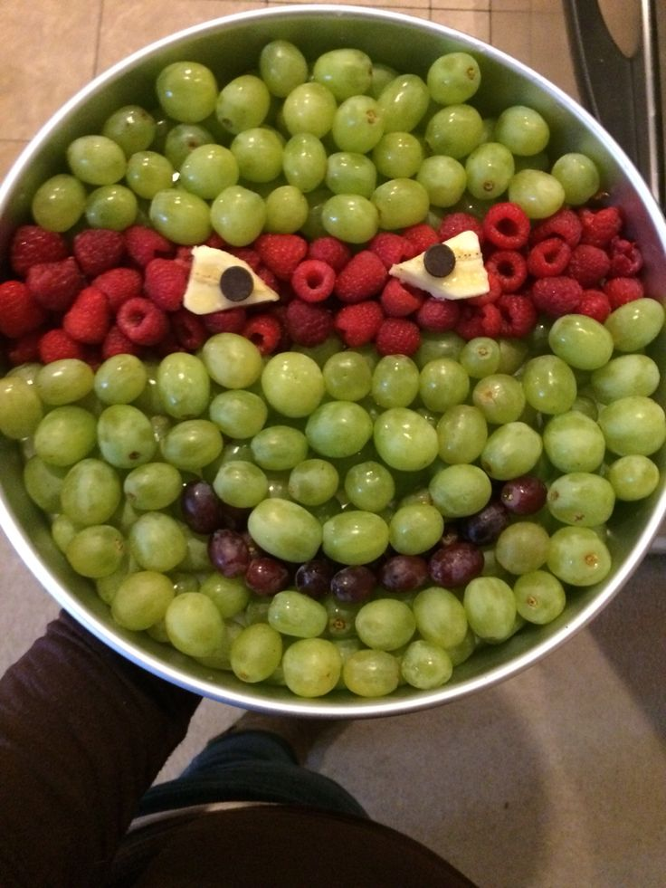A ninja turtle fruit tray I made for my nephews bday.. I used a large cake pan did 2 layers of grapes and raspberries, then cut bananas for the eyes with chocolate chips for the pupils. ^.^ easy peasy... It took 1 box of SAMs club green grapes and 1 box of Sams raspberries. A few dark grapes and 1/2 a bananas.. ^.^ (I woulda done better on the eyes of i had more time! This was last min! Lol) #ninjaturtle #tmnt #party #fruittray #boys #birthday