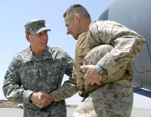 Joint Chiefs Chairman Marine Gen. Peter Pace (right) is greeted by Army Gen. David Petraeus in Baghdad on Monday.