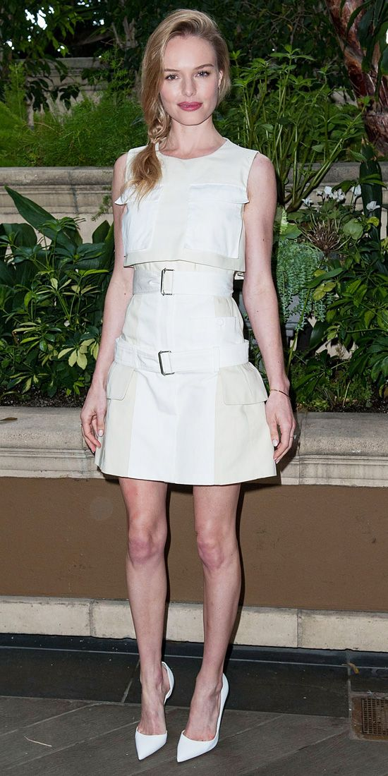 At the Homefront press conference, Bosworth promoted her new film in a light two-toned crop top and matching belted high-waisted skirt, both by Alexander McQueen. She stayed true to the color scheme with white Christian Louboutin pumps.