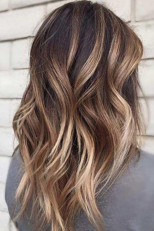 Stilvolle lange geschichtete Frisuren für Damen