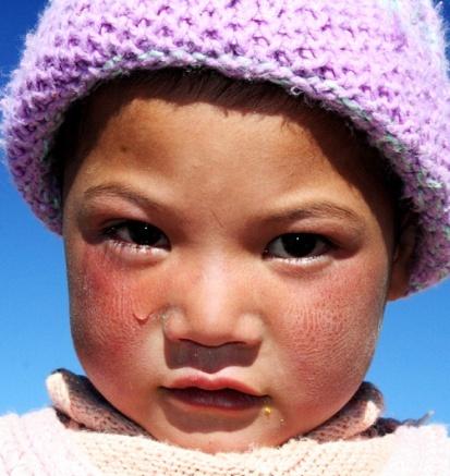 Vejrbidt. Knastør luft og brændende sol efterlader tydelige spor i ansigterne på de lokale i Zanskar.