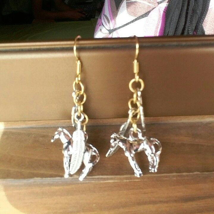 Horse and feather earing made from me
