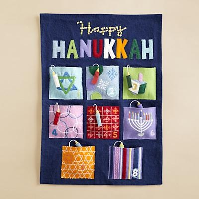 Hanukkah calendar features eight pockets with hanging candles; one for each night of the festival. Conceal candy surprises, a message or small gift in the pockets. $49.00