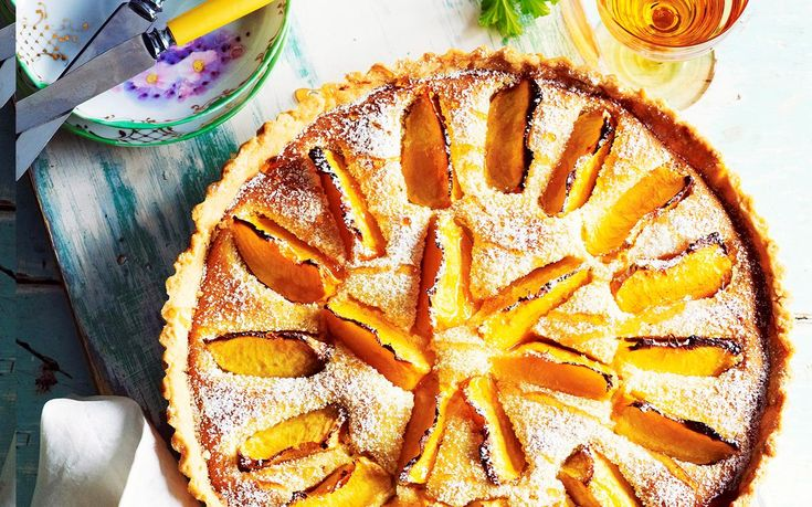 Indulge in a baked, fruity treat with this peace and rose frangipane tart. Drizzle with honey to serve and enjoy the peach slices and almond undertones. Recipe by the Australian Women's Weekly.