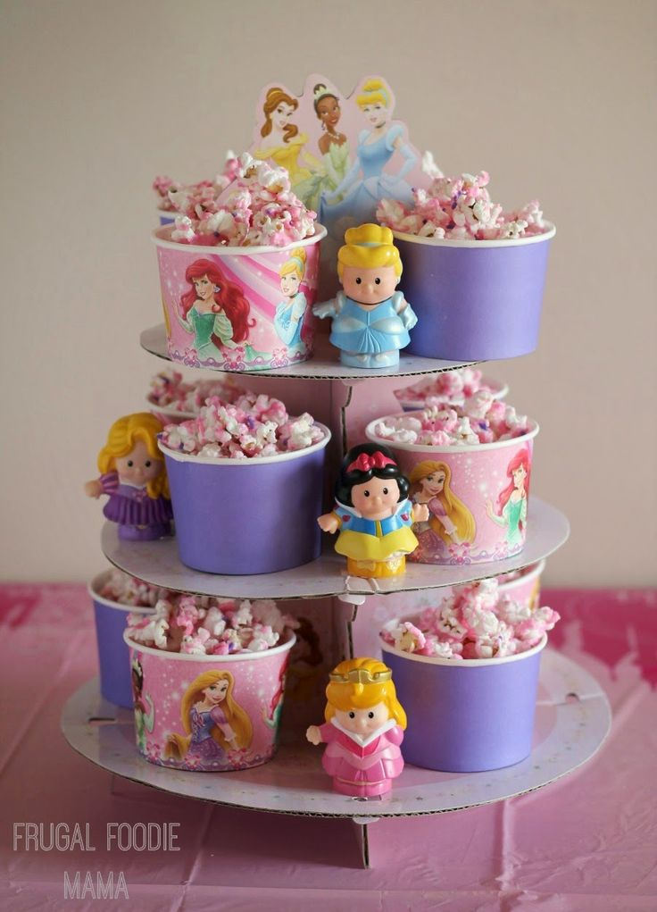 Use a Disney princess cupcake stand to display cups of Sparkling Princess Popcorn
