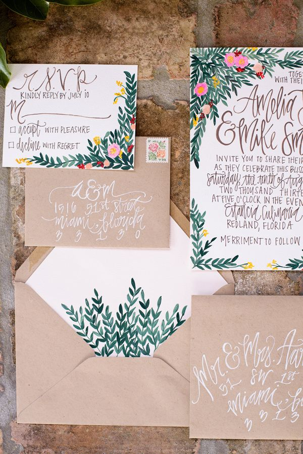 kraft invitation suite with leafy envelope liner, photo by Starfish Studios http://ruffledblog.com/tuscany-inspired-wedding-ideas #weddinginvitations #stationery
