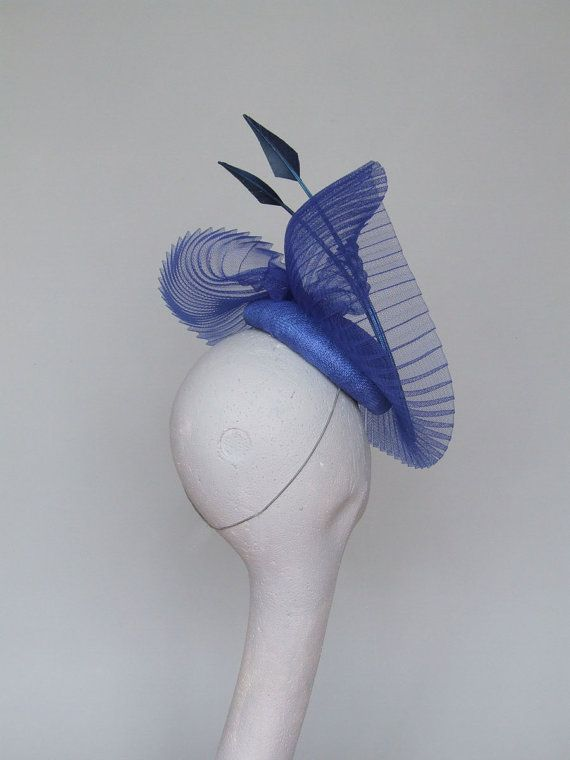 An elegant hand blocked royal blue sinamay fascinator/headpiece with crinoline and feather detail.  An exquisite way to accessorise for that special occasion.   Secured by hat elastic.  Please allow 5 days for this item to be made/  Can also be made in black, navy red and pale coral.