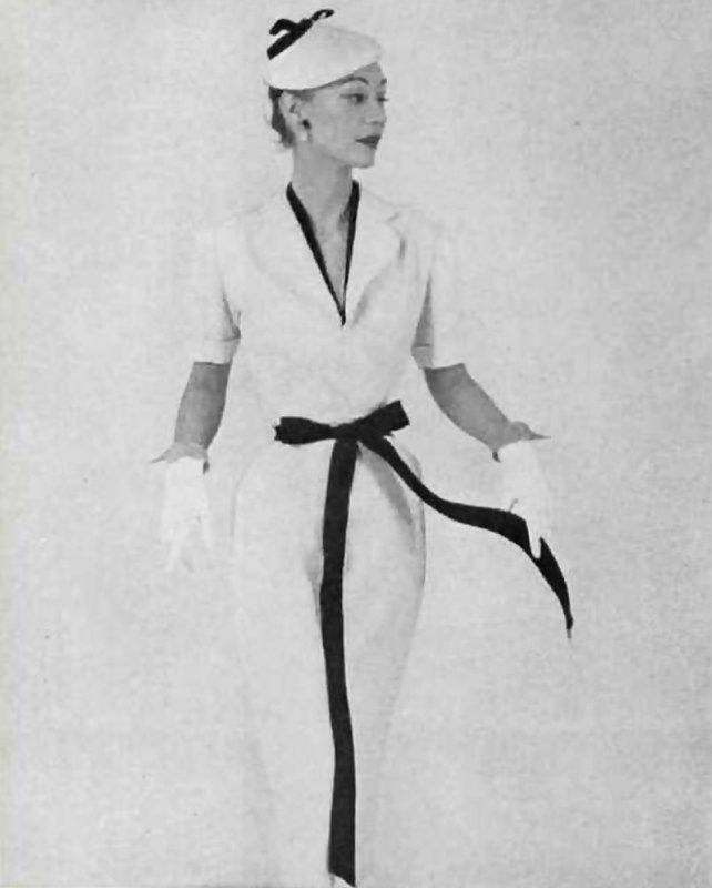 Model in white dress with black ribbon by Givenchy, hat to match, photo by Yurak, 1952