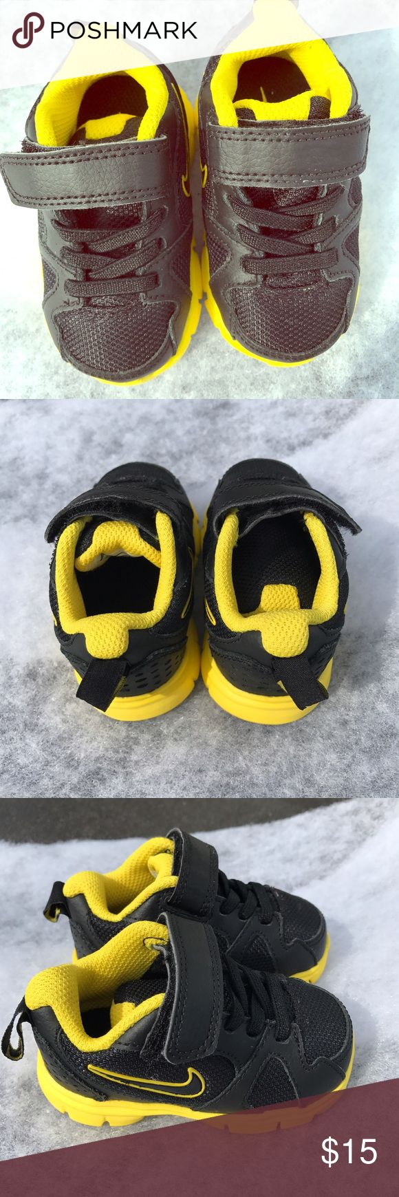 Nike shoe boys 4 Yellow and black Nike shoes size 4 never worn. Like new! Nike Shoes Sneakers