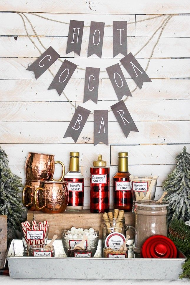Keep winter wedding guests warm and busy with a DIY hot cocoa bar filled with extra fun toppings like toffee and peppermint sticks.