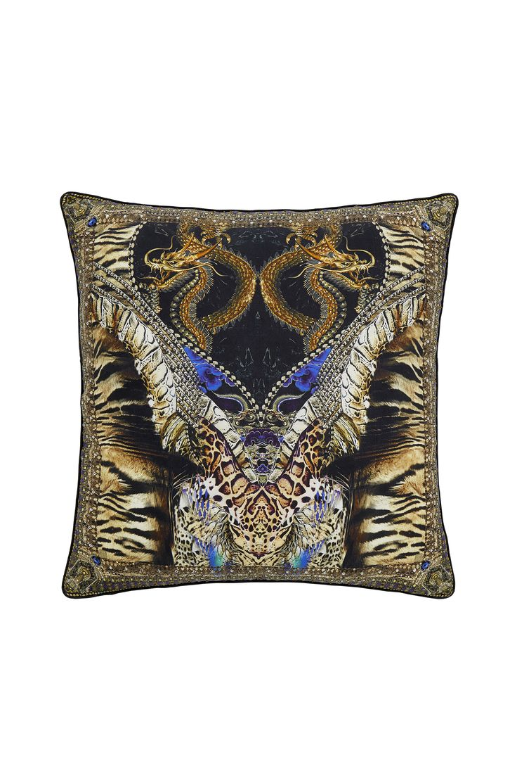Bring a statement splash of bohemian luxury to your home with the Dragon Lady Large Square Cushion Cover. Inspired by animals of the Chinese zodiac, this piece features patterning to front and back, contrast piping to edges and a delicate pure silk construction. Mix and match with the CAMILLA Chinese Whispers collection to inject bohemian luxury and colour into your home. - Printed front and back - Contrast piping - Invisible zip opening FABRICATION: 100% SilkDIMENSIONS: 65cm X 65cm