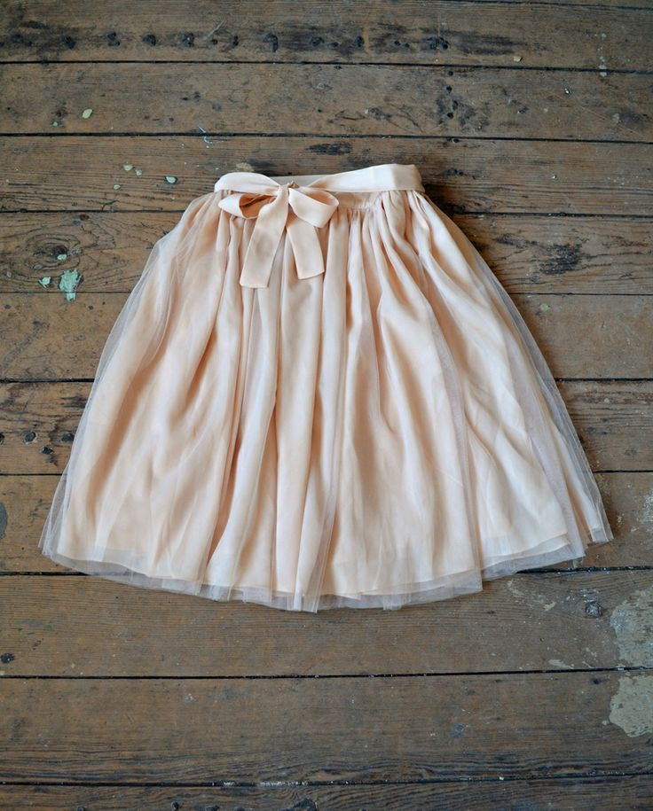 skirt (with blousy shirt tucked in and heels)