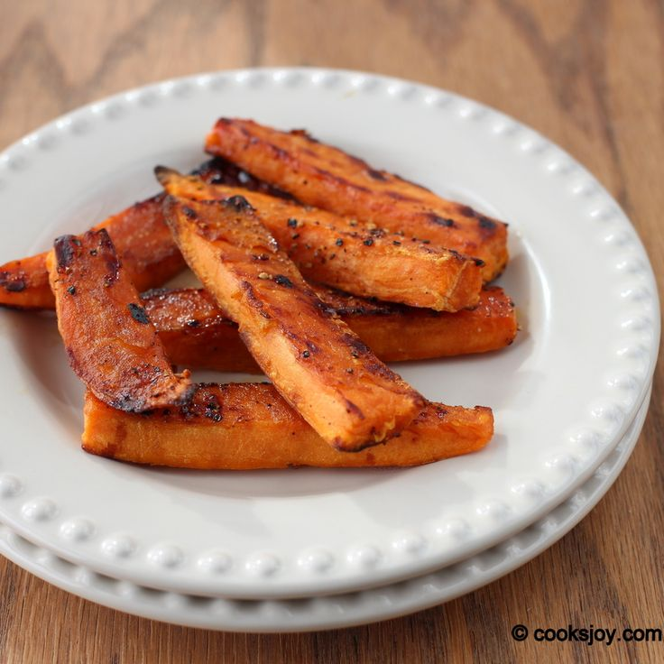 Baked Sweet Potato Wedges. Peeled sweet potato wedges are tossed with ...