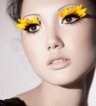 Artistic sunflower petal false lashes.