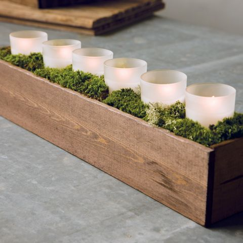 Love the box and the moss. Could have some with fewer votives, interspersed with taller floral arrangements.