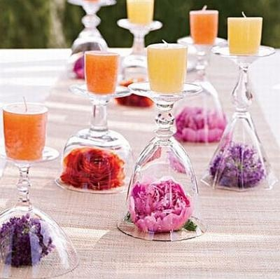 Table deco - Purple / Silver / White flowers under diff. style glasses with Purple/Silver/White/Black candles on top!
