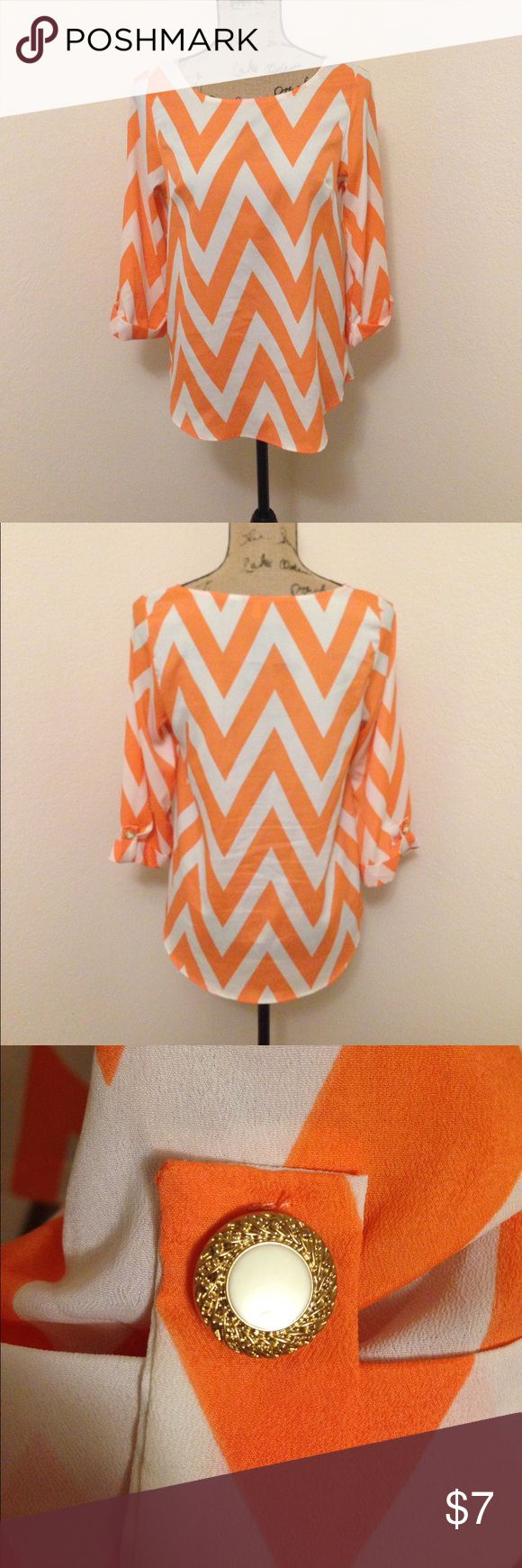 Chevron top with button detail on sleeve. Orange chevron top with button detail on sleeve Tops Blouses