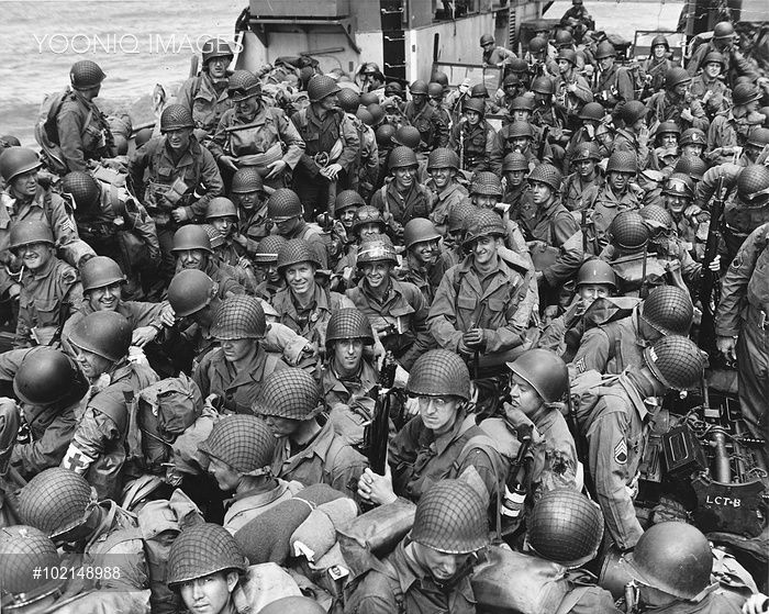 A dramatic photograph of the tightly massed ranks of US assault troops in a landing craft crossing the English channel en route for the Normandy landings. D-Day began on June 6th, 1944 at 6:30am and was conducted in two assault phases û the air assault landing of allied troops followed by an amphibious assault by infantry. The Normandy landings were the largest single-day amphibious actions ever undertaken, involving close to 400,000 military and naval personnel.