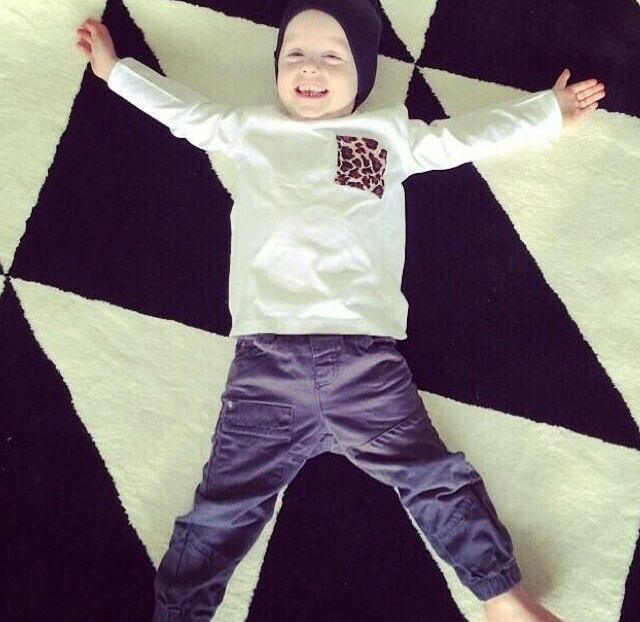 This little cutie wearing his Sticks + Stones leopard pocket tee.