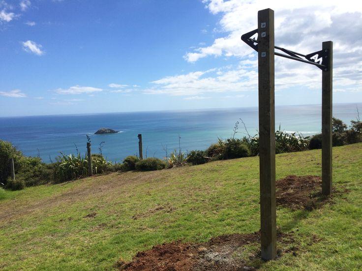 Pullups with a view! Outdoor pullup bar installed at Murawai beach NZ