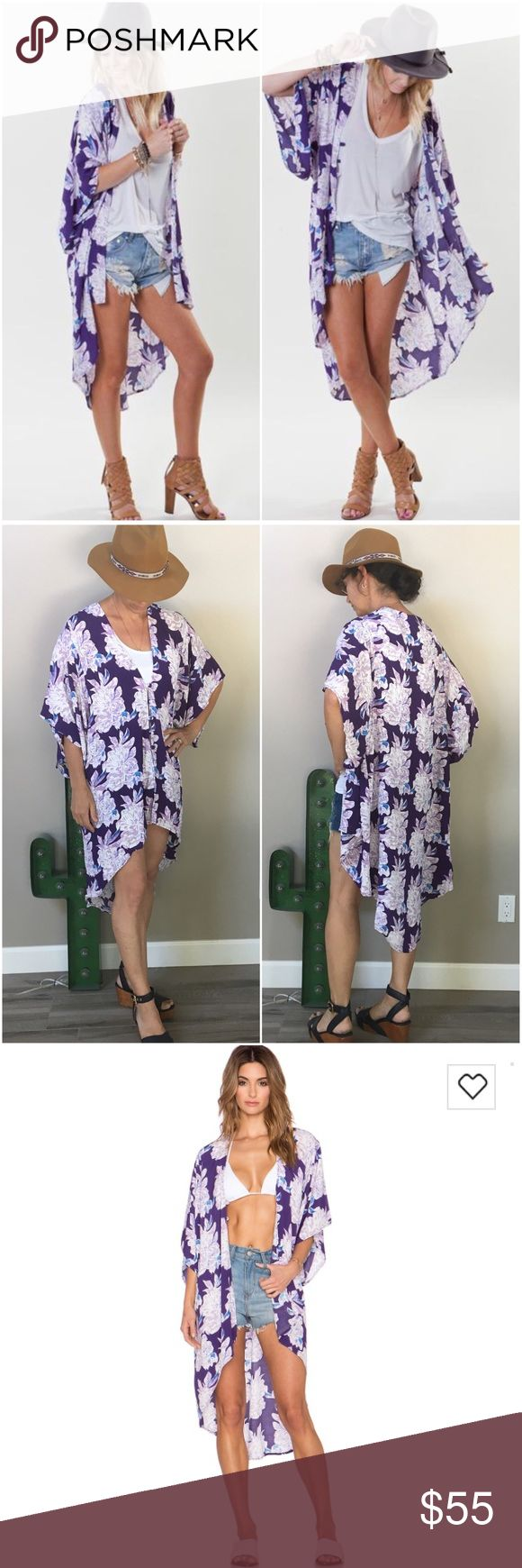 """Flynn Skye Stevie Kimono Purple Punch This flowy Flynn Skye kimono is anything but ordinary. You can throw it over anything to create the perfect Boho look -- swimsuit, cut offs, jeans. It works amazingly w/your favorite booties, summer sandals or wedges! One size fits all & that is so true! Will look awesome on Size 0 or plus-size. Can be worn open or buttoned up. 100% rayon. Asymmetrical hem. I am 5'5"""" and 125 lbs & am wearing it in 2nd photo. Worn twice for photos & in perfect condition…"""