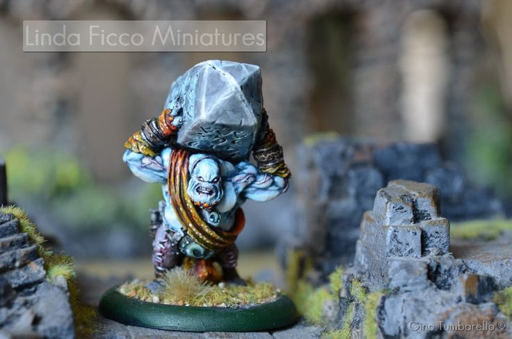 A Troll carrying a code written on a giant stone!