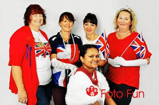 Group of women ready for  visit of the English Royals
