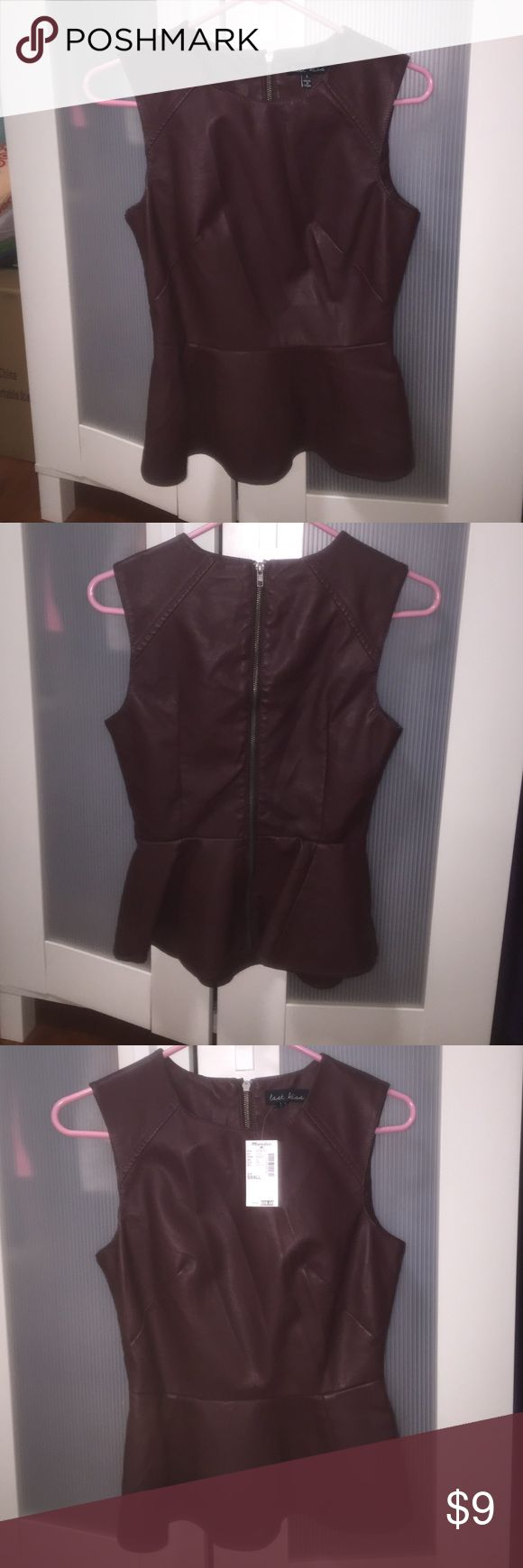 Plum- colored, pleather peplum top Stylish, pleather peplum top. Form-fitting. Comfortable. Never worn. Tag still attached. Mandee Tops Blouses