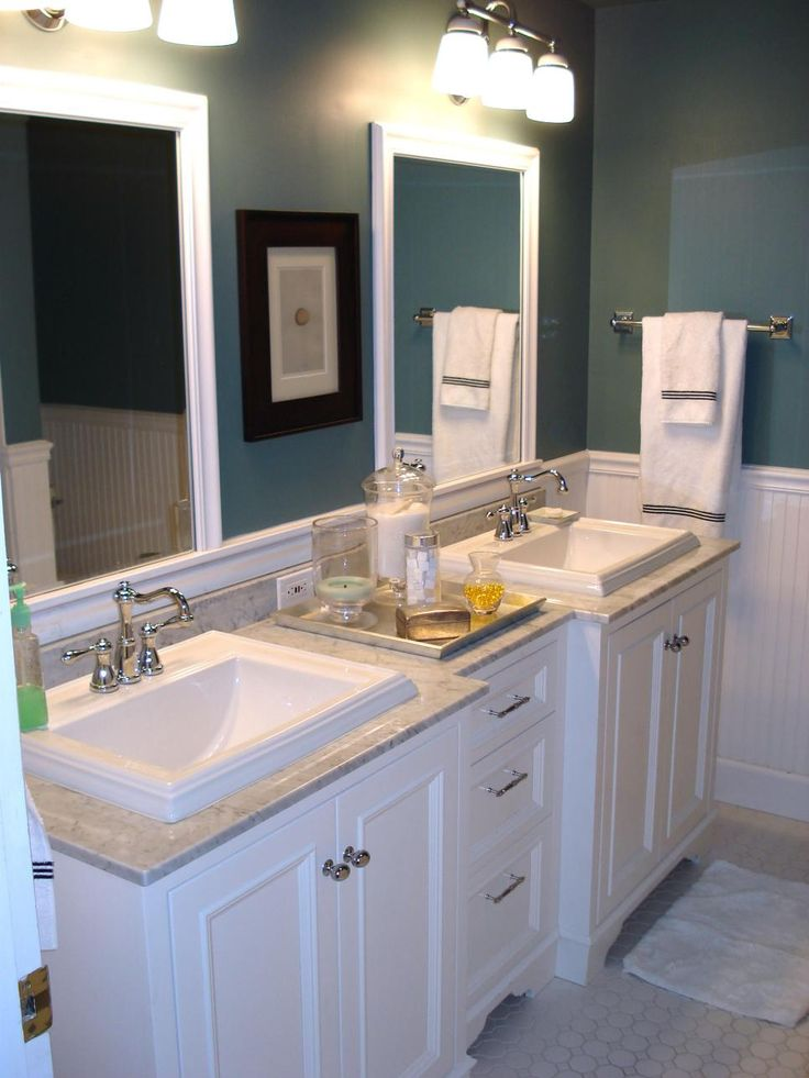 Now that's more like it. The bathroom was demolished for a traditional cottage-style makeover. Dual sinks help with the morning rush while an earthy, slate-blue paint color is a refreshing update.