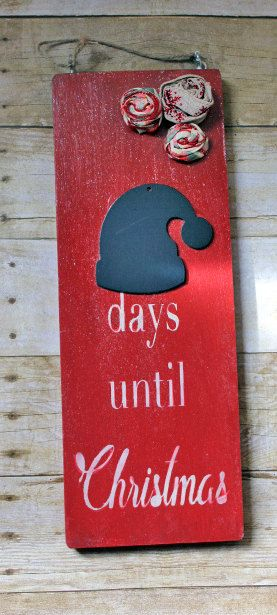 READY TO SHIP! Get your kids excited counting down the days until Christmas. This Christmas Countdown Sign is made from reclaimed wood, handpainted and sealed, with a Santa Hat Chalkboard, ribbon rosettes, and sprinkled with Magic Santa Dust (glitter mod podge). The eye screws are screwed in on top with a jutestring hanger. The wood itself measures 16x5 3/4 will ship 3 day priority.