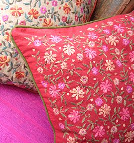 Kashida Cushion covers - Embroidered by a group of women in Delhi. Their main aim is to work with women from difficult social and economic backgrounds, particularly women from very conservative families who needed help but who were not allowed by tradition to work outside the home.