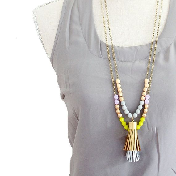 TWO specially priced Tassel Necklace, Long Leather Tassel Necklace, Color block Bead Necklace  Two long striking necklaces are made with 8mm Czech glass beads that connect seamlessly to an Antique Brass bead chain the beautiful big 2 faux leather tassel is of superb quality and has a lovely gold toned brass cap.  1. Gold Tassel has grey and cream beads 2. Silver Tassel has Lilac, Matt Gold and Chartreuse beads.  The lengths are 26 and 28.  Shipped in a gift box.
