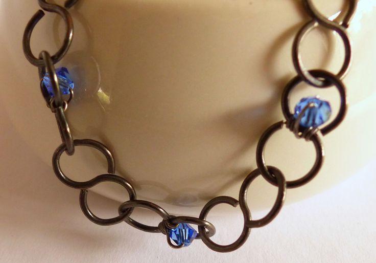 A personal favourite from my Etsy shop https://www.etsy.com/au/listing/242901048/black-copper-bracelet-blue-swarovski