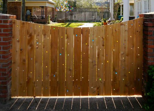 Turn an ordinary wood fence into a colorful accent in your backyard using glass bead. Sunlight comes through them for a prism effect