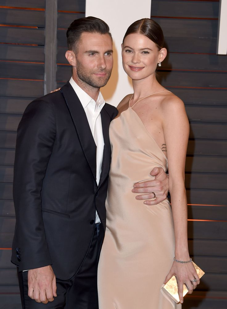 Behati Prinsloo is 27 and Adam Levine is 37. Totally thought Adam was younger than that xD!!!!!