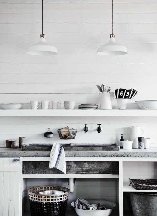 White kitchen with a concrete sink in the beautiful, rustic barn at The Estate Trentham. Photo - Lisa Cohen.