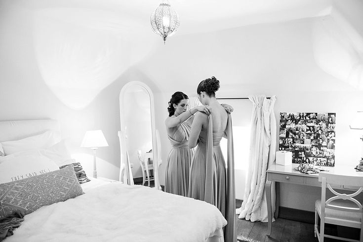 Two bridesmaids getting ready