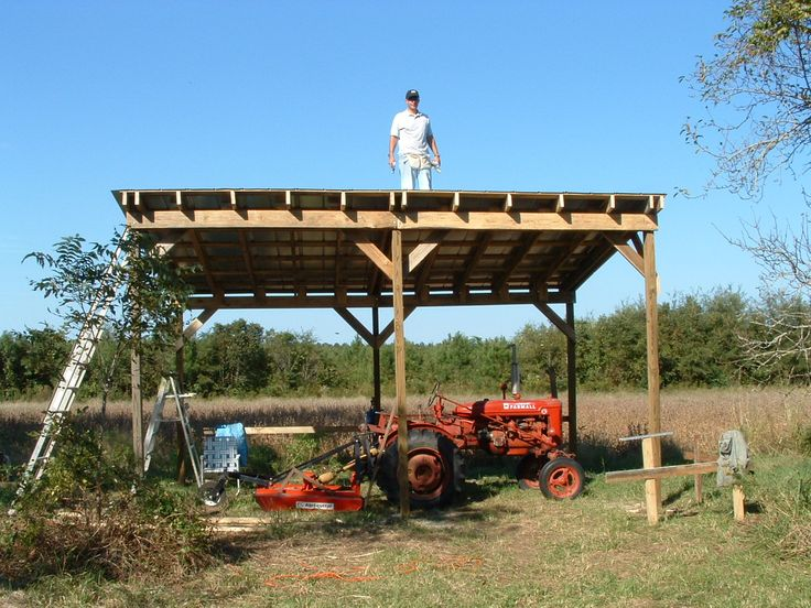 harry and neighbor building the tractor shed in 2006