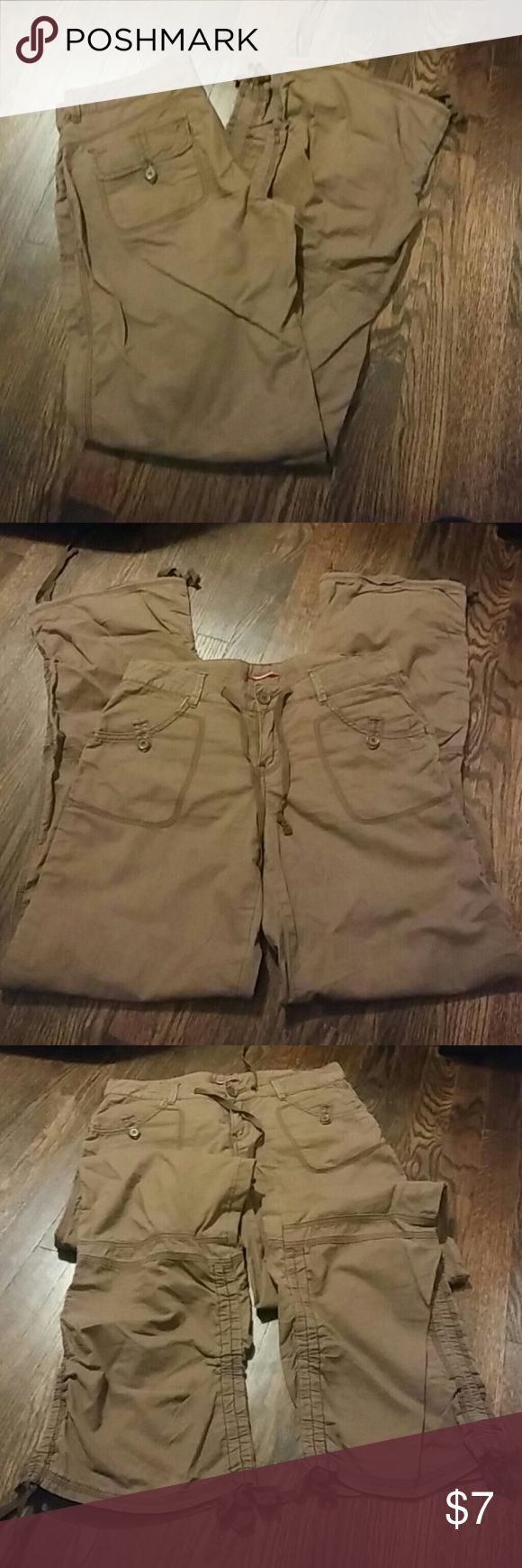 Casually comfy brown pants Cargo style with ties on the bottom of each leg to convert into capris. Comfy thinner material. UNIONBAY Pants