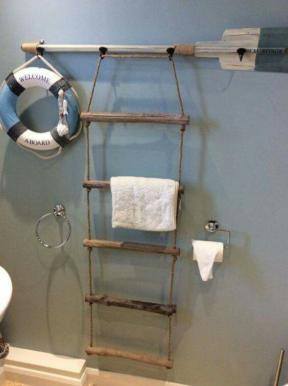 How cute is this! Make a boat ladder and paddle in to a towel rack