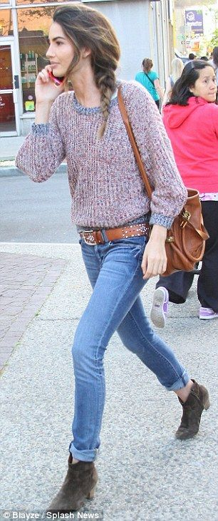 Casual style: The Victoria's Secret model's day wear consisted of a knit sweater, cropped denim trousers and brown ankle boots