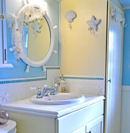 Whimsical Nautical Ship Wheel Mirror.... http://www.completely-coastal.com/2016/09/decorative-bathroom-mirrors-coastal.html