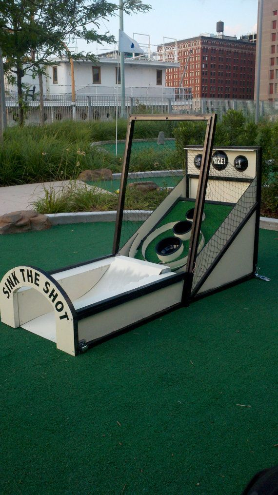 "Custom SkeeBall MiniGolf Obstacle by MarcusConradPoston on Etsy, $500.00 [   ""Mini Golf Obstacle Ideas Ideas for mini golf pop up! More golf DIY ideas at"",   ""Custom Skee-Ball Mini-Golf Obstacle by MarcusConradPoston on Etsy"",   ""Custom Skee Ball Mini Golf Obstacle I Love, Ski And Washington Dc - - jpeg"",   ""Hone your skee-ball AND putting skills anywhere on this portable, hand-made obstacle. This unique item makes the perfect gift for any and all"",   ""Guide to Golf Rules – Golf Swing Pro""…"