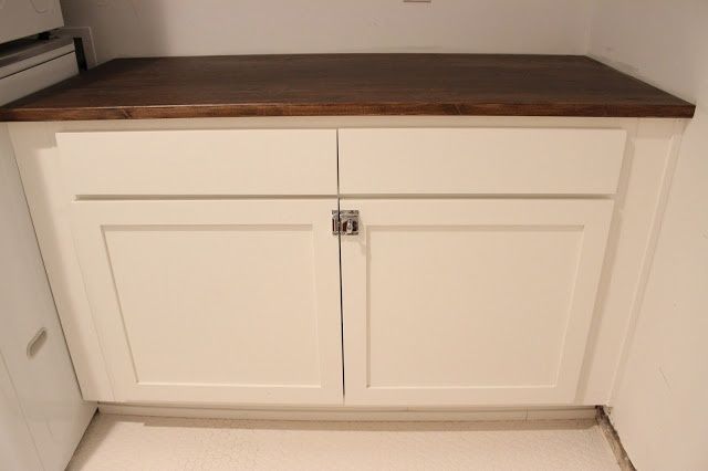 Dream Book Design: Ikea Desk Top Turned Laundry Room Cabinet Top
