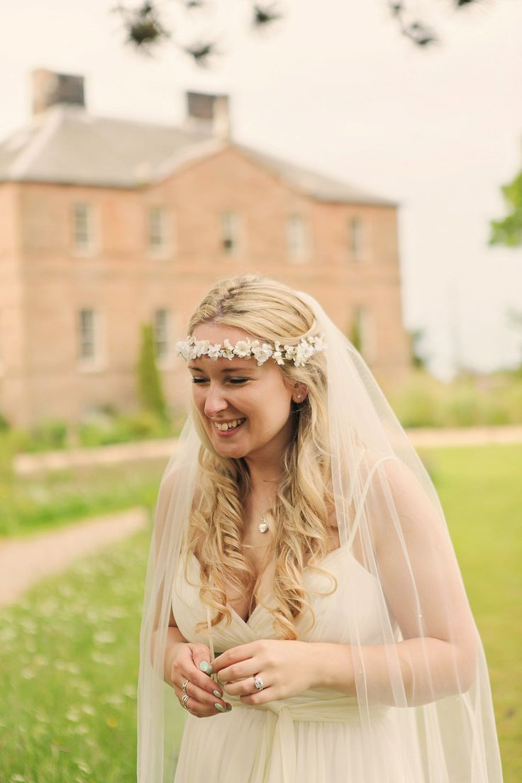 Bride wears a white silk flower crown | Photography by Helen Russell.